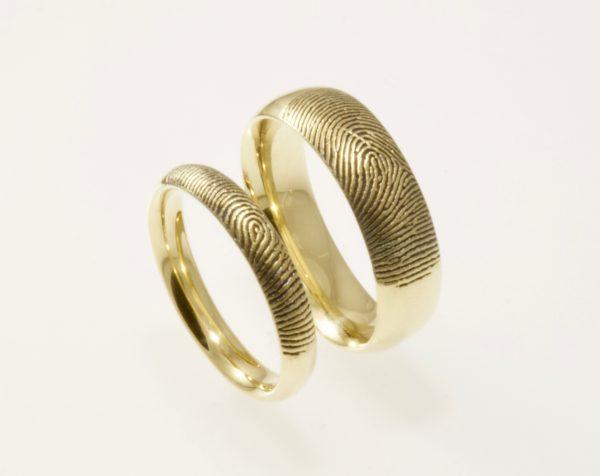 Custom Brent&Jess yellow gold fingerprint rings