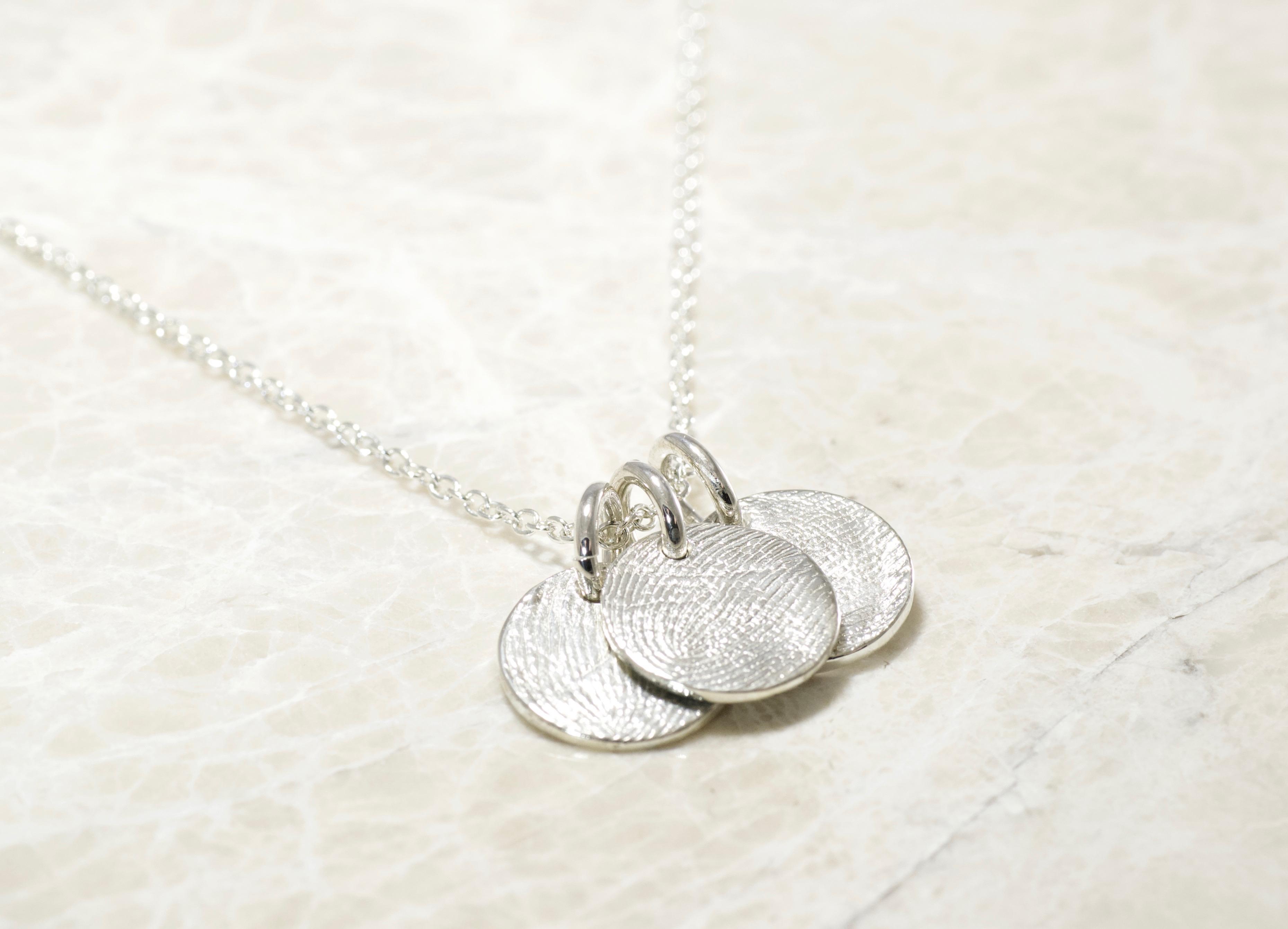 Custom Brent&Jess family fingerprints charm necklace.