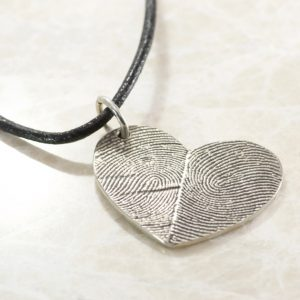 Custom Double Thumbprint Pendant in Sterling silver with your unique fingerprints! This pendant is available with the prints darkened or left natural. The first picture shows natural, the second show darkened. Once the listing is purchased we'll send you a kit to capture the fingerprints you'd like on your pendant. Send the kit back to us, and we'll make the magic happen in our coastal South Carolina studio!