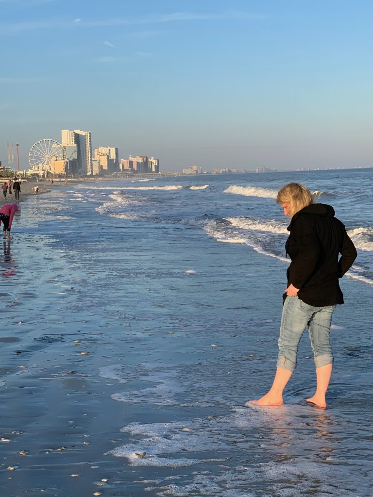 Jess shark tooth hunting in Myrtle Beach